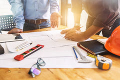 Architecture engineering teamwork meeting at workplace to plan d. Rawing a new blueprint busy working hard for apartment building small business of their Stock Images