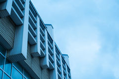 Architecture facade of modern office building against the sky Stock Photos
