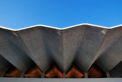 Architecture feature in wave style. Building against beautiful clear blue sky Royalty Free Stock Photo