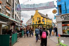 Architecture of Galway, Ireland. GALWAY, IRELAND - JULY 13, 2016: Crowd in the Shop street in Galway, Ireland. Galway will be European Capital of Culture in 2020 royalty free stock photos
