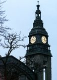 Architecture of Germany. Cityscapes in Hamburg. Trip around Europe. The tower with clock behind branches stock image