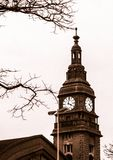 Architecture of Germany. Cityscapes in Hamburg. Trip around Europe. The tower with clock behind branches royalty free stock photo