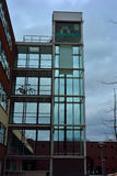 Architecture, glass elevator shaft. Architecture, beautiful  glass elevator shaft an a bike Royalty Free Stock Photo