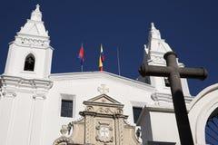Architecture of the historic center of Quito. Jesuit Church of La Compania and Banco de Ecuador Stock Images