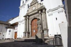 Architecture of the historic center of Quito. Jesuit Church of La Compania and Banco de Ecuador Royalty Free Stock Photo