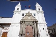 Architecture of the historic center of Quito. Jesuit Church of La Compania and Banco de Ecuador Royalty Free Stock Image