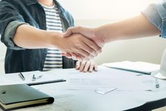 Architecture and home renovation concept with blueprint shaking partner hand.  royalty free stock photo