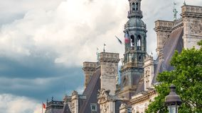Architecture of The Hotel de Ville City Hall with french flag on tower timelapse, the building housing the local. Administration of the city of Paris. Cloudy stock video