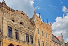 Landmark attraction in Brasov, Romania. Houses architecture on the Republicii Street Royalty Free Stock Photos