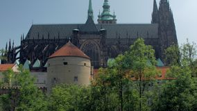 Architecture of huge old gothic building of Saint Vitus Cathedral, panoramic side view. In sunny day stock video