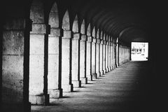 Architecture interior arc. Antique spanis walkway, architecture interior arc, long row of colonnade columns and arcs Stock Image