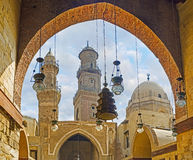 The architecture of Islamic Cairo. CAIRO, EGYPT - OCTOBER 10, 2014: The numerous arabian lights in courtyard of Al-Nasir Muhammad funerary complex with the Stock Photos