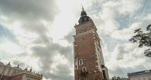 Architecture Krakow - the Old Town Hall Tower. Background clouds. Timelapse stock footage