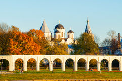 Architecture landscape - arcade of Yaroslav Courtyard and ancient St Nicholas cathedral, Veliky Novgorod, Russia Royalty Free Stock Images