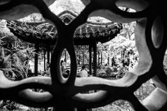 The architecture of Lingering Garden in Suzhou, China. Black white symmetric yard courtyard tradition stair yellow decorative pattern religion fire pavilion Royalty Free Stock Photos