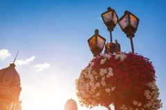 Architecture of Lviv streets on blue sky background. Lamp with flowers. Architecture of Lviv streets on blue sky background at sunset. Lamp with flowers royalty free stock photos