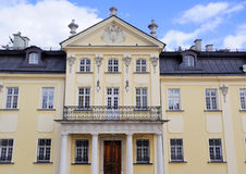 Architecture of Lviv. Yellow house with white columns royalty free stock photo