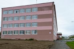 Architecture of Magada, Russian Federation. MAGADAN, RUSSIA - JUL 4, 2014:Primary school in Magadan, Russia. Magadan was founded in 1929 and now it's the stock image