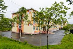 Architecture of Magada, Russian Federation. MAGADAN, RUSSIA - JUL 4, 2014: Primary school number 17 of Magadan, Russia. Magadan was founded in 1929 and now it's Stock Images
