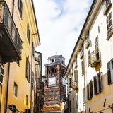Architecture of the City of Cuneo. Architecture of the Medieval Piedmont City of Cuneo in Italy. Church with clock on the bell tower Royalty Free Stock Image