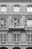 Italian balcony in Cuneo. Architecture of the Medieval Piedmont City of Cuneo in Italy. Vintage Italian balcony in Mediterranean style. Black and white picture Royalty Free Stock Photography