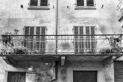 Italian balcony in Cuneo. Architecture of the Medieval Piedmont City of Cuneo in Italy. Vintage Italian balcony in Mediterranean style. Black and white picture Stock Photos