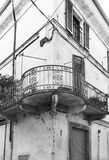 Italian balcony in Cuneo. Architecture of the Medieval Piedmont City of Cuneo in Italy. Vintage Italian balcony in Mediterranean style. Black and white picture Stock Photo