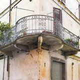 Italian balcony in Cuneo. Architecture of the Medieval Piedmont City of Cuneo in Italy. Vintage Italian balcony in Mediterranean style Royalty Free Stock Photo