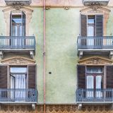 Italian balcony in Cuneo. Architecture of the Medieval Piedmont City of Cuneo in Italy. Vintage Italian balcony in Mediterranean style Stock Image