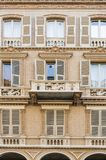 Italian balcony in Cuneo. Architecture of the Medieval Piedmont City of Cuneo in Italy. Vintage Italian balcony in Mediterranean style Stock Photos