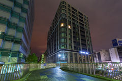 Architecture of Minato Mirai 21 district in Yokohama at night Stock Photo
