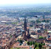 Architecture, Minster church in Freiburg, Germany. This is a panorama picture which include the old minster church in Freiburg, Germany. With a helicopter passby Royalty Free Stock Photography