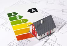 Architecture Model and Energy Efficiency Label. Energy efficiency label with architecture model and blueprint stock photography