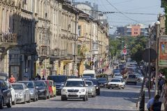 Architecture and movement of cars on the central street of the city of Lviv, Ukraine. LVIV, UKRAINE - JULY 05, 2018 : Architecture and movement of cars on the stock photography