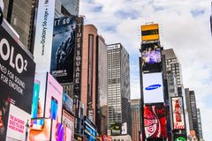 Architecture of New York, USA. NEW YORK, USA - SEP 22, 2015: Publicity screens at the Times Square, a major commercial neighborhood in Midtown Manhattan, New stock images