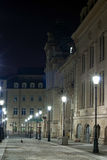 Architecture by night. Historical building lighted by street lamps Stock Photography