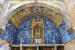 Architecture in Obidos, Portugal. Beautiful medieval architecture in the old town Obidos in Portugal. Part of ancient house decorated with blue azulejo panel of royalty free stock images