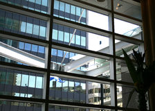 Architecture office buildings. Modern building architecture seen through interior glass windows Stock Image