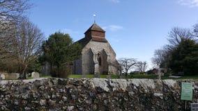 Sussex village church. Old church sussex yard religous flint spire Stock Photo