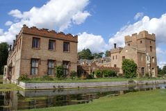 Architecture. Old moated architecture with battlements, tower, and castellated roof Royalty Free Stock Photos