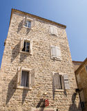The architecture of the old Montenegro: Wooden shutters on a stone wall of the house stock photography