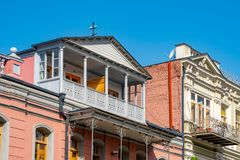 Architecture of old Tbilisi, Exterior of an old houses with wood balcony. Agmashenebeli street stock photo
