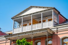 Architecture of old Tbilisi, Exterior of an old houses with wood balcony. Agmashenebeli street royalty free stock photography