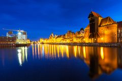 Architecture of the old town in Gdansk over Motlawa river at night Stock Photography