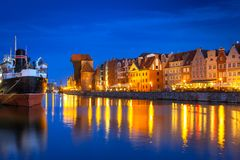 Architecture of the old town in Gdansk over Motlawa river at night Stock Photos