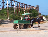 Architecture oOf Cuba. Horse drawn cart and frame of old building at sugar mill in Cuba Stock Photography