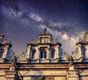 Architecture outside church. Night time starry sky. Retro stale. Stock Photos