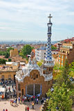 Architecture in the Parc Guell, Barcelona, Spain. Showing the pavilion house and spire at the entrance to the park and gardens designed by Antoni Gaudi Stock Image