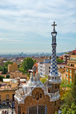 Architecture in the Parc Guell, Barcelona, Spain. Showing the pavilion house and spire at the entrance to the park and gardens designed by Antoni Gaudi Stock Photography