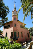 The architecture of Park Guell. Barcelona. House in art nouveau, where the dome of the tower and chimneys are decorated with coloured ceramics , nicknamed the Royalty Free Stock Image